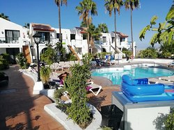 "The small unheated pool in A block. Sun beds provided but guests ""reserve"" them early with towels every morning."