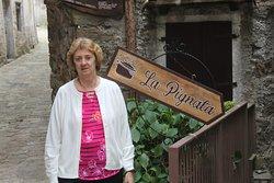 Cecelia poses by the sign for La Pignata