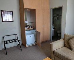 Room 302, closet to small bathroom.
