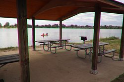 A shelter and two picnic tables