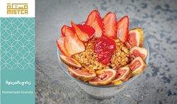 home made granola, Greek  yogurt and fresh figs and strawberry