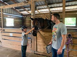 My Grandson telling his dad how to pet the horse