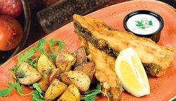 Turbot served with sautéed potatoes and skordalya sauce