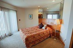 Bedroom with Patio Doors at Glidden Lodge Beach Resort in Door County, WI
