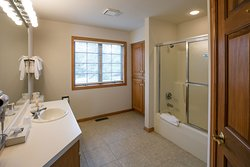 Bathroom with Shower at Glidden Lodge Beach Resort in Door County, WI