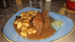 Slow cooked tuna pasticada with homemade gnocchi