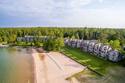 Glidden Lodge Beach Resort from the Air: View of the Wide Sand Beach, Luxury Condo Suites and Wo