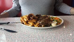 Hot Beef sandwich with veggies and fries. Very tender beef.