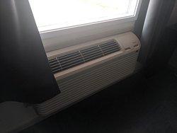 Curtains go across over the heater/air con.