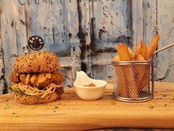 Chicken burger w/ Sriracha mayo, coleslaw, tomato, greens in toasted sesame bun and served w/ side of proper chips