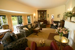 The elegant sitting room where you can watch TV or read a book.  Gorgeous garden and pool views.