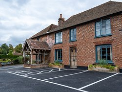 Front of pub with car parking