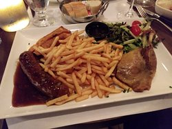 Terrific combo plate of Duck leg, Elk sausage, Wild Boar Egg Roll, French fries & salad. Fantastic!
