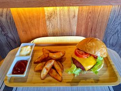 Our bestseller, West Coast Cheese Burger. One of the various yummy food items at the cafe'. Great with ice cold beer or cocktails.
