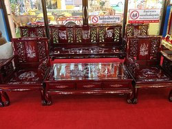 Iridiscent lacquer sofa set awaits the weary pilgrim in a quiet corner of Wat Tha Ka Rong