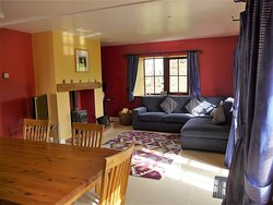 The open plan dining/living room in the Beltie Byre self catering cottage