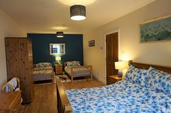 The family bedroom in the Beltie Byre self catering cottage