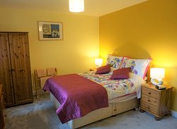 The double ensuite bedroom in the Beltie Byre self catering cottage