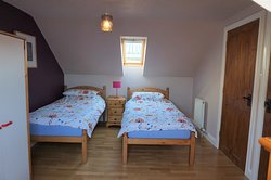 The upstairs ensuite twin room in the Beltie Byre self catering cottage