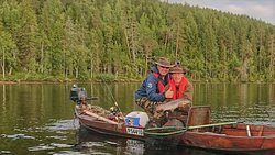 Brown trout fishing in wilderness lake