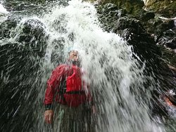 Experiencing the power and freshness of standing under a waterfall!