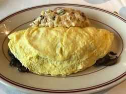 09-08-19 Goat Cheese Omelet with cream hash browns.