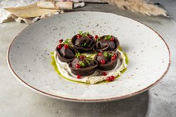 Dumplings with venison, smoked sour cream and soaked lingonberries
