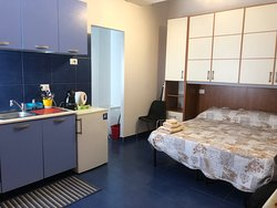 spacious room with a kitchen