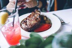 16-oz Bone-in Rib Eye Steak (prepared medium, with roasted potatoes, and market vegetables) Photo by: Mike Bradley Photography
