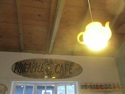 Above the counter, look! a glowing teapot!