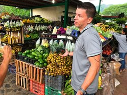 Oscar talking about the fruits and vegatables at a farmers market