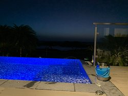 Private pool at night with wine chilling