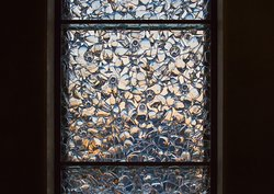"""Our beautiful glass window - commissioned by the Canberra Glassworks, titled """"Vineyard Vitrine"""" where glass and light come together."""