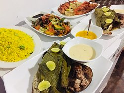 Whole mullet fish and mix grilled seafood platter with Garlic rice and grilled vegetable