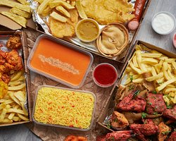 Baba G Tandoori Exclusive Munch Box Set Meals Deals. Munchy Box One - £9.99 2 Sausages, 1 Pudding, 1 Fish, 2 Fritters, Chips, Tub of Gravy, Bottle of Juice.