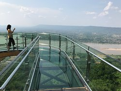 GLASS SKYWALK located inside the temple grounds at Wat Pha Tak Suea, in the province of NONGKHAI, Thailand. From here, one can see the plateaus of Laos across the Mekong River.