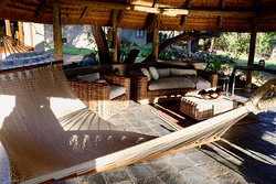 hammock and outdoor but undercover sitting area.