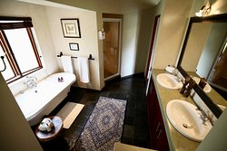 All rooms come with en suite bathrooms fitted with double basins, bath and shower.