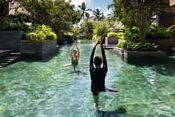 Complementary aquatic yoga class