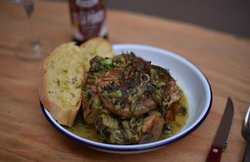 Warm hearty slow cooked goat with green herbs (frikase), a classic recipe!