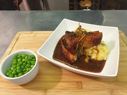 Crispy belly pork, served with mashed potatoes and garden peas & accompanied with a honey & mustard sauce.