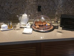 Pictures of the breakfast buffet, room and lobby.
