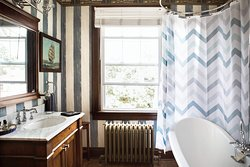 """""""The Nautical Room"""" - Queen room includes: Private bath, queen bed, radio, 36' Smart TV and basic cable."""