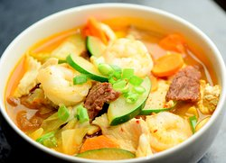 Spicy Korean Noodle Soup  - Jung Pong style spicy noodle soup is a spicy Korean chili chicken broth, with chicken, shrimp, beef, and fresh cabbage, carrots and zucchini. Not too spicy and we can adjust spice level. Always made FRESH to order!