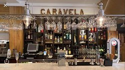 Caravela Restaurant offers a wide choice of portuguese starters , tapas , meat , fish and vegetables lover dishes just as delightful house specials . We take pride for our cuisine , our traditions and and who we are