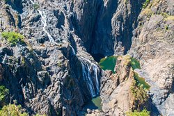 Green pools of water dot lower section of Barron Falls in Barron Gorge National Park. (AlpinerHut)