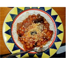 Attractively served Moussaka stew on rice