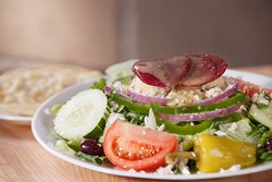 Our mouth watering Greek salad made exactly the way you like it! Choose your ingredients: Lettuce, tomatoes, cucumbers, red onions, green peppers, kalamata olives, pepperoncini peppers, potato salad, feta cheese, and beets. Served with pita bread.