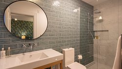 Ensuite bathrooms are fully tiled with walk in showers
