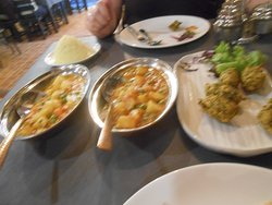 Potato and pea curry on left, vegetable korma in the middle and spinach and potato pakora on the right.